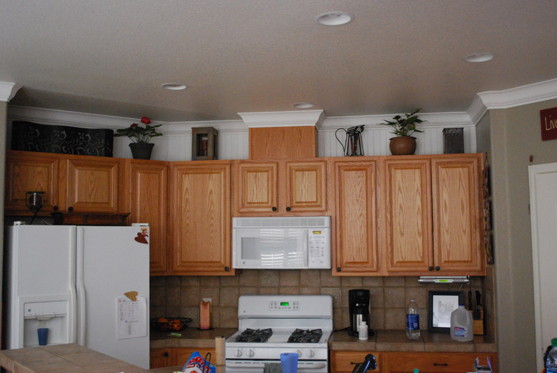 Adding crown molding to kitchen cabinets bar cabinet for Adding molding to kitchen cabinets